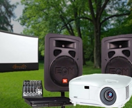 Outdoor projector and sound system display with inflatable screen.