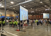 Large projection and screen setup in Silicon Valley warehouse.