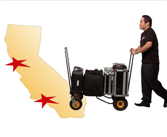 Man pushing cart with AV equipment.
